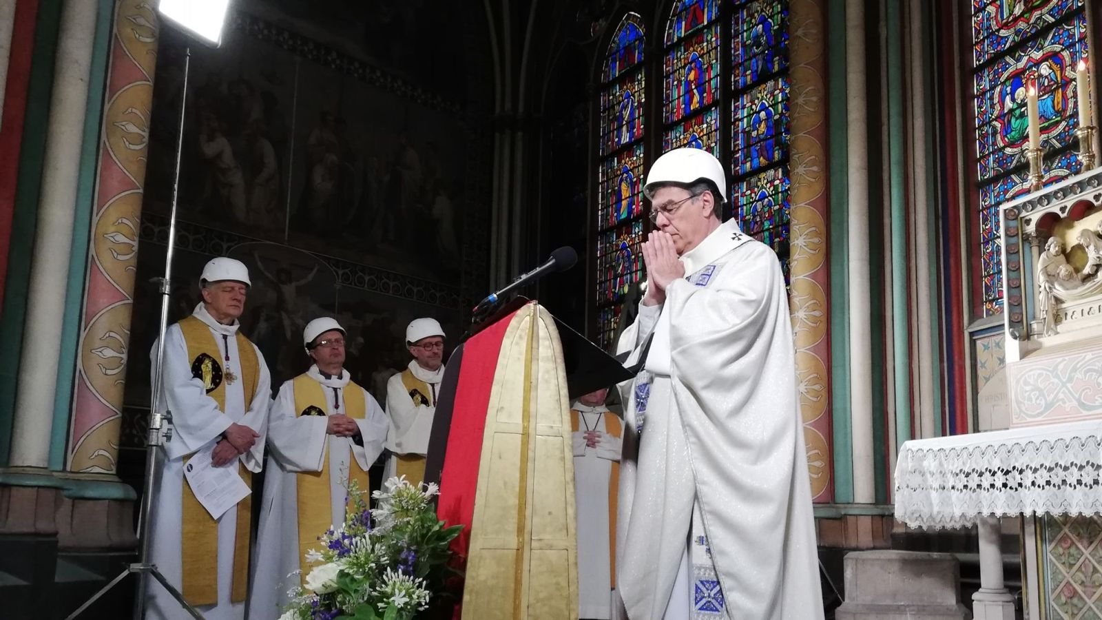 The Archbishop of Paris Michel Aupetit leads the first mass in a side chapel two months to the day after a devastating fire engulfed the Notre-Dame de Paris cathedral on June 15, 2019, in Paris. - The Notre-Dame cathedral in Paris will host its first mass on June 15, 2019, exactly two months after the devastating blaze that shocked France and the world. For safety reasons, the mass led by Archbishop of Paris Michel Aupetit will be celebrated on a very small scale. Worshippers will be expected to