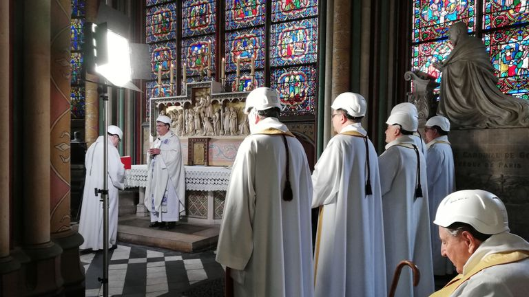 TOPSHOT - The Archbishop of Paris Michel Aupetit, holds the first mass in a side chapel two months to the day after a devastating fire engulfed the Notre-Dame de Paris cathedral on June 15, 2019, in Paris. - The Notre-Dame cathedral in Paris will host its first mass on June 15, 2019, exactly two months after the devastating blaze that shocked France and the world. For safety reasons, the mass led by Archbishop of Paris Michel Aupetit will be celebrated on a very small scale. Worshippers will be