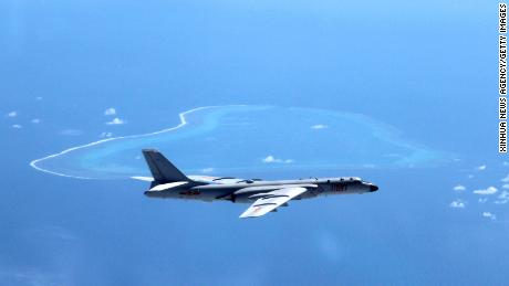 A July 2016 image shows a Chinese H-6K bomber patrolling islands and reefs in the South China Sea.