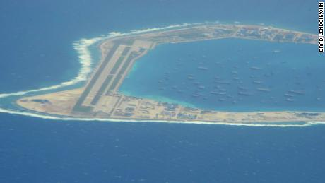 The Chinese-controlled artificial island of Mischief reef in the South China Sea, as seen by CNN from a US reconnaissance plane on August 10, with a runway and area for ships to anchor.