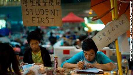 Students do their homework at a study area occupied as part of the Umbrella Movement on October 10, 2014, in Hong Kong.