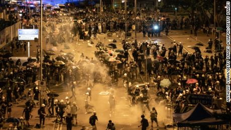 Police fire tear gas at protesters outside the Legislative Council Complex in the early hours of July 2, 2019 in Hong Kong.
