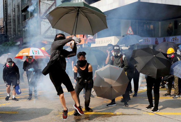 Hong Kong leader apologizes for mosque water cannon incident after day of violence