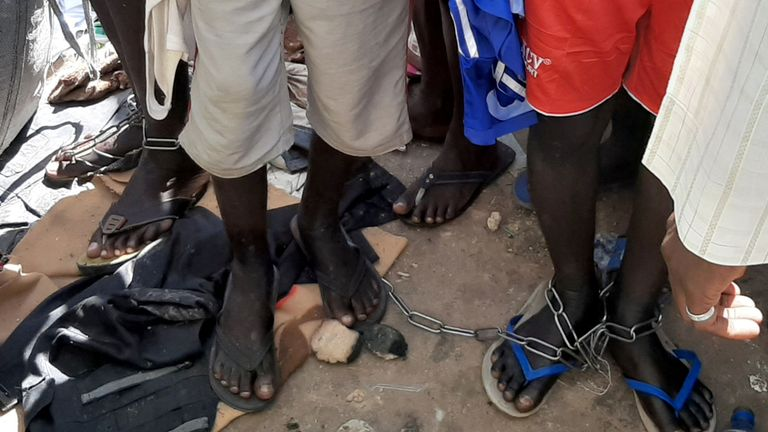 People with chained legs are pictured after being rescued by police in Sabon Garin, in Daura